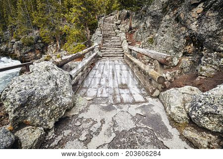 Wooden Bridge And Stone Stairs In The Yellowstone National Park.