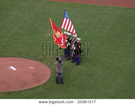 Marines Hold Flags During National Anthem