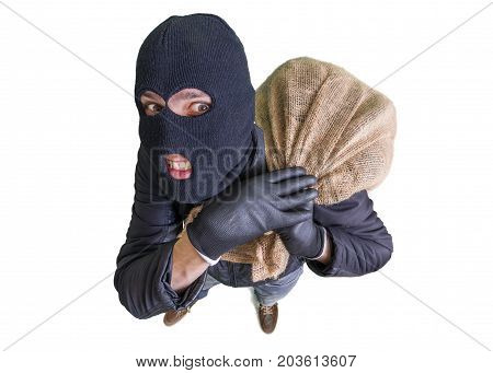 Thief Or Burglar Is Carrying Bag Full Of Money. View From Above.