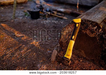 Axe on ground. Woodworking tool and wooden background. Important tool in forest