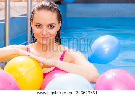 Girl Relaxing In Swimming Pool