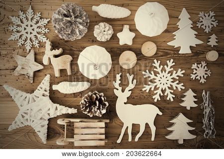 White Festive Flat Lay With Many Christmas Decoration, Like Snowflakes, Ball, Sleigh, Fir Cone And Tree. Vintage Rustic Wooden Background With Instagram Filter And Frame