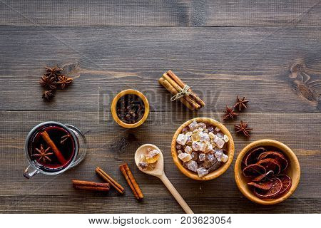 Merry christmas in winter evening with warm drink. Hot mulled wine or grog with fruits and spices on wooden desk background top view mockup