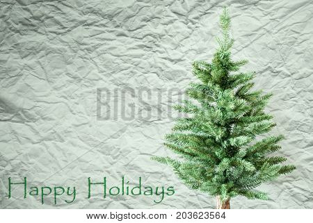 Crumpled Paper Background WIth English Text Happy Holidays. Christmas Tree Or Fir Tree In Front Of Textured Background.