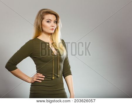 Attractive Blonde Woman Wearing Tight Green Khaki Dress