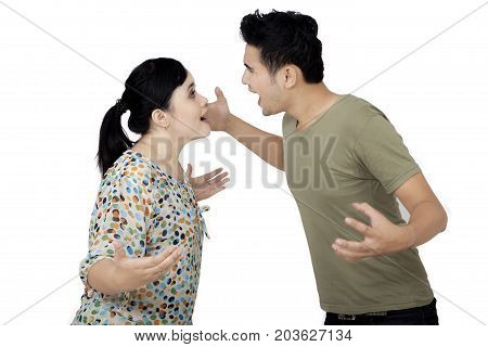 Image of an Asian couple shouting each other while having a quarrel isolated on white background
