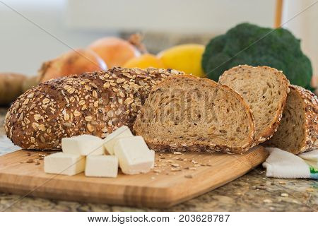 Whole wheat bread on wooden cutting board.