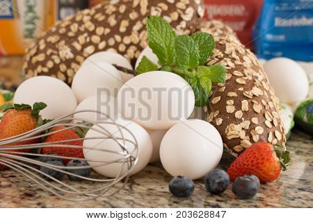 Eggs bread and ingredients prepare for cooking on marble table.