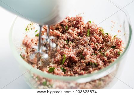 Step By Step Levantine Cuisine Kibbeh Preparation : Mixing The Ingredients To Prepare Kibbeh Into A