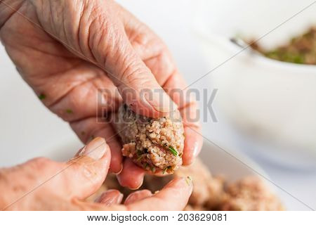Step By Step Levantine Cuisine Kibbeh Preparation : Close Up Of A Senior Woman Hands Shaping A Kibbe