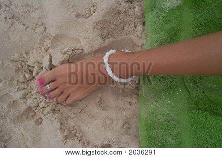 Tanned Foot At The Beach In The Caribbean