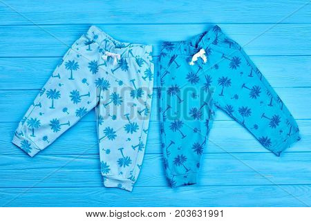 Casual trousers for little kids. Online shop modern children trousers. Trendy summer baby pants, top view.