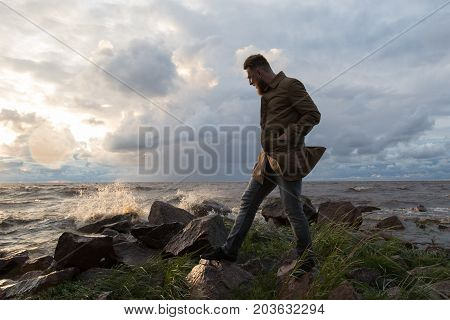 man by the sea in stormy weather