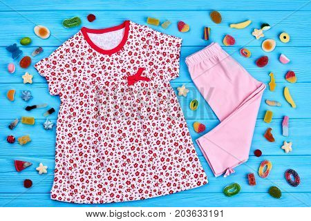 Collection of infant girl summer garment. Natural brand summer clothing for little girls. Baby-girl summer casual apparel.