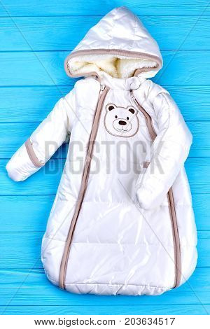 Infant baby winter bodysuit. Newborn baby warm down romper, baby boys and girls winter bodysuit infant hoodie down jumpsuit, top view.