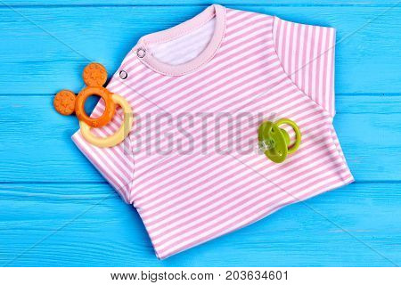 Cotton striped shirt for baby-girl. New brand cotoon bodysuit and accessories for baby-girl, top view. Natural soft clothes for kids on sale.