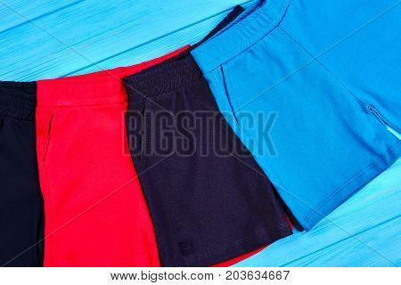 Set of new cotton shorts for toddlers. Close up of new collection textile short pants for kids. Baby summer clothing on sale.
