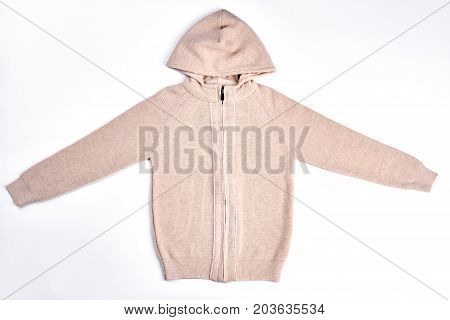 New knitted hooded sweater for girl. High quality brand knit hooded jumper isolated on white background. Kids knit outfit.