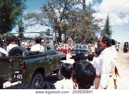 NUKU'ALOFA, TONGATAPU / TONGA - CIRCA 1990: A military jeep follows a luxury Mercedes-Benz car, carrying King Taufa'ahau Tupou IV, during a holiday in Tonga's capital city.
