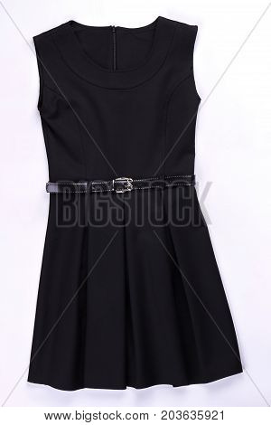 Beautiful black belted pleated dress. Classic pleated black dress isolated on white. Black dress with pleats on sale.