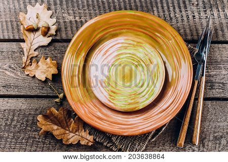 Autumn Table Setting. Thanksgiving Dinner Plate With Fork, Knife And Leaves On Rusticwooden Table Ba