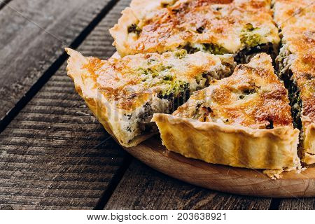 Pie With Mushrooms, Chicken And Herbs On The Wooden Table