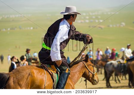 Mongolian Man Cowboy Riding Horse Crowded