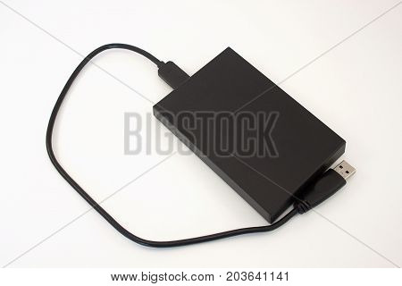 Black external hard disk isolated on the white background. Data storage.