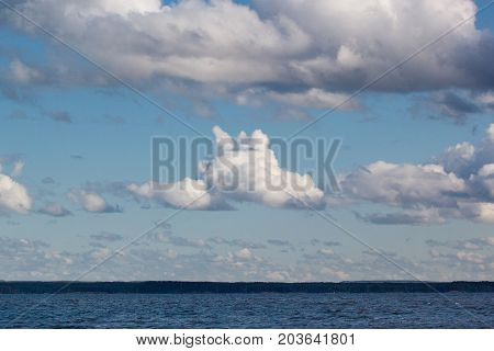 Blue sky with beautiful clouds at sunset. Summer evening.