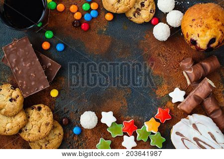 Assortment of products with high sugar level. Food that's bad for skin and teeth. Space for text
