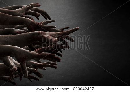 Scary zombie hands reaching in dark room