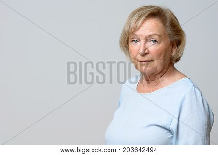 Unemotional Attractive Elderly Woman