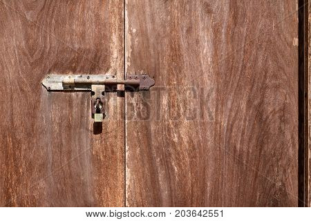 The old wooden door with latchkey in the temple Thailand.
