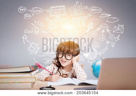 Easy start up business planner management concept : Portrait of a cute girl sitting on office desk with smiley face thinking with a business idea sketch depicted over head.
