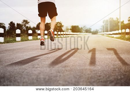 Athlete Starting jumping start running track with text 2017 shadow to 2018 new year Start to new year next future