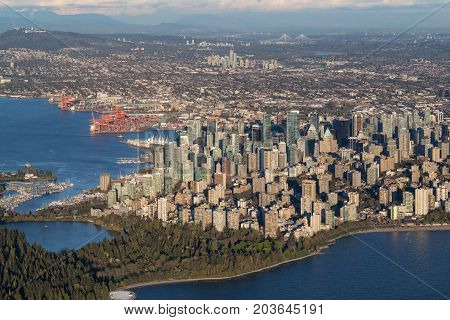 Aerial view of Downtown Vancouver City British Columbia Canada during an evening before sunset.