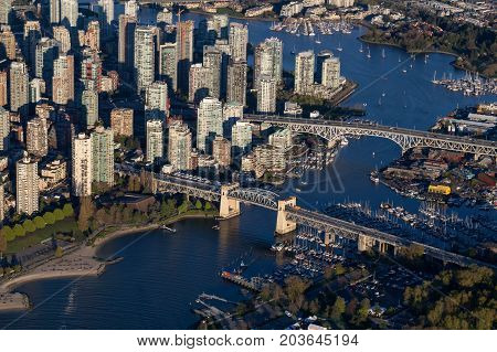 Burrard Bridge Granville Island and False Creek. Taken in Downtown Vancouver from an aerial perspective.