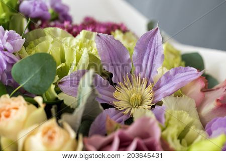 Close-up floral composition with roses and mix flowers on a light background. caramel-cream gamma. close-up