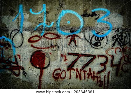 Grunge background with graffiti and writings on a concrete wall. Wall with graffiti