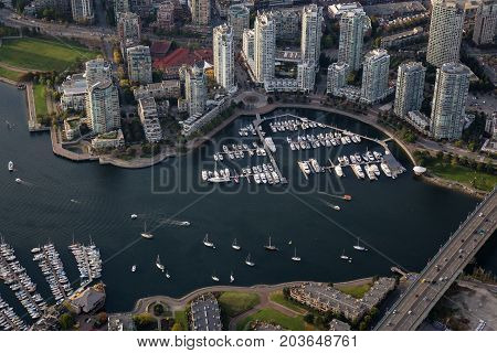 False Creek Cambie Bridge Marina and Residential Buildings viewed from an aerial perspective in Downtown Vancouver British Columbia Canada.