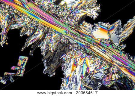 colorful microscopic shot of Sodium nitrate microcrystals in polarized light