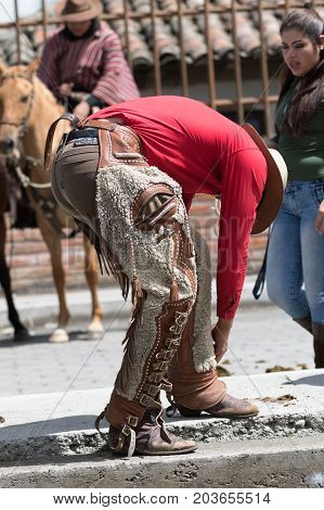 June 10 2017 Toacazo Ecuador: man arranging his chaps before rodeo
