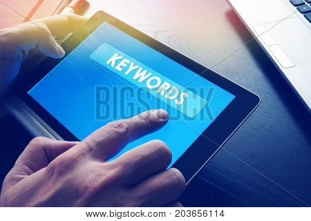 Word Keywords on a tablet as a part of SEO.