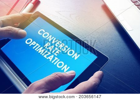 Man is holding Conversion rate optimization report.