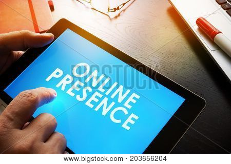 Man is holding report about Online Presence.