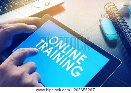 E-learning concept. Online training on a screen of tablet.