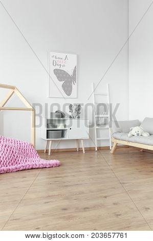 Pink Braided Blanket On Floor