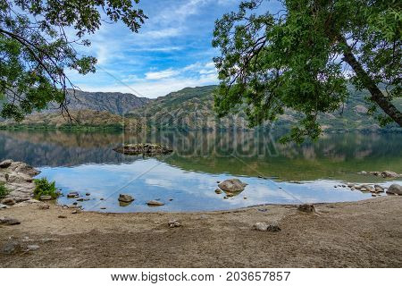 Wide angle view of Sanabria lake beach in Spain