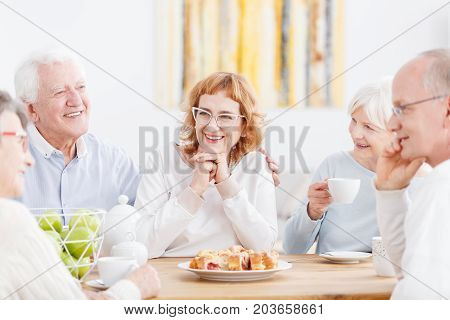 Elderly Couple With Friendly Neighbors