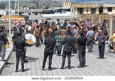 June 10 2017 Toacazo Ecuador: marching band setting the tone at the morning gathering of horsemen before the weekend rodeo
